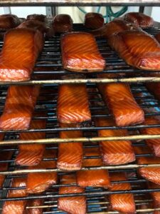 Racks of golden brown salmon fillets at the Boston Smoked Fish company